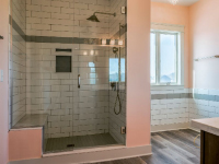 bathroom with large tile shower