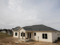 front of custom home with green shingles