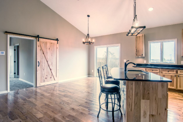 kitchen with barn door and bar stool chairs