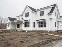 front of custom home with white shingles