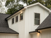 exterior of custom home with white siding exterior