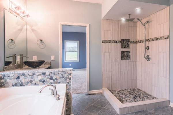 white bathrooom with stone tile