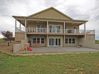 rear view of home with double decks and open patio area