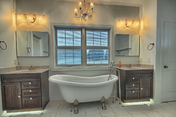 bathroom with large white barn tub